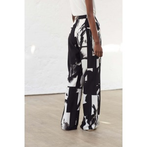 GOSPEL - Wide high-waisted printed silk trousers